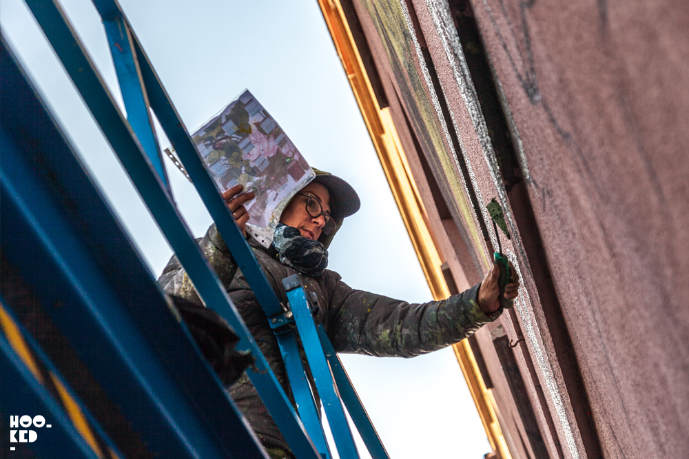 Work in Progress shot of Spanish Street Artist Lula Goce at work on her Waterford Mural.