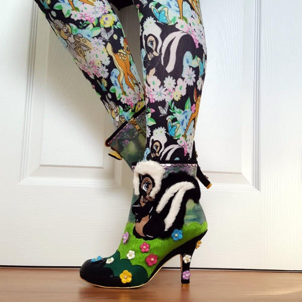 wearing Disney Bambi patterned tights and skunk fluffy applique ankle boots