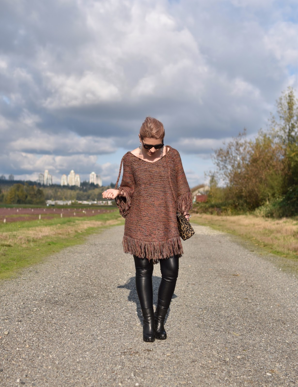 Outfit inspiration c/o Monika Faulkner - fringy poncho-sweater, vegan leather leggings, and platform booties