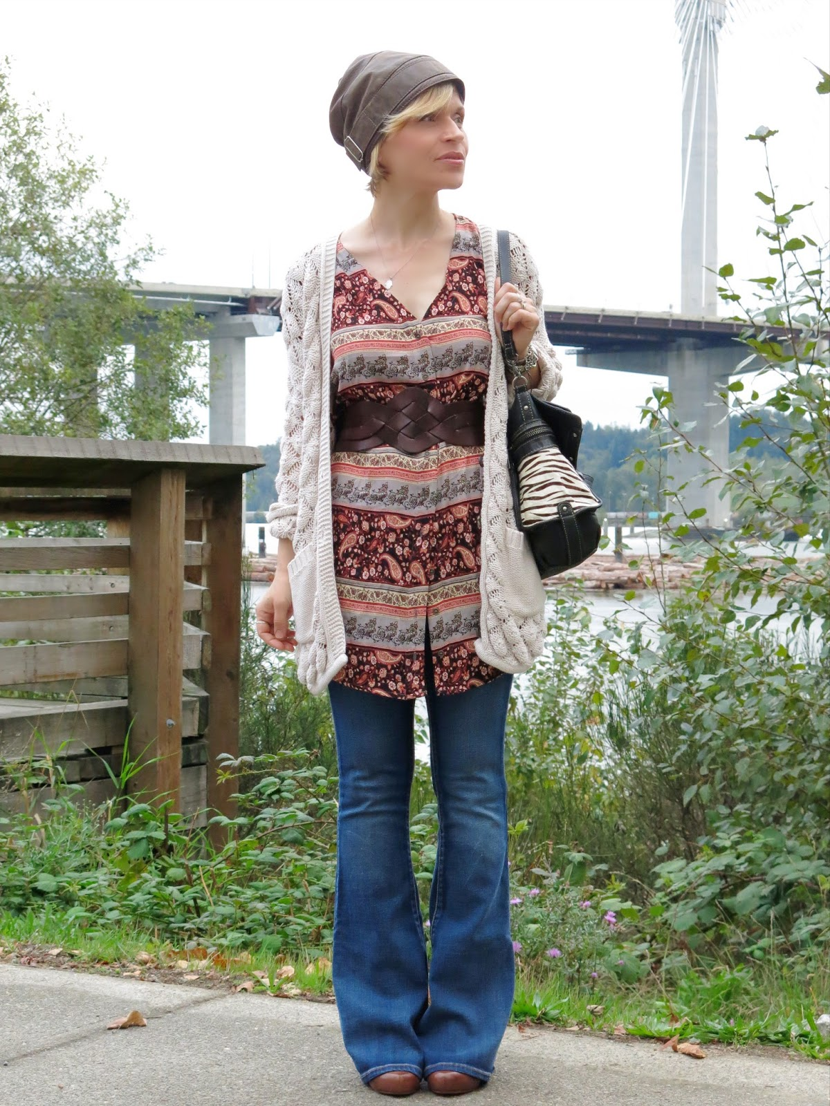 Surviving chaos:  flare jeans, floral tunic, grandpa cardigan, and leather beanie