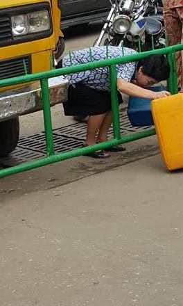 Fuel Scarcity: Chinese Woman Spotted With Jerry Cans In Lagos