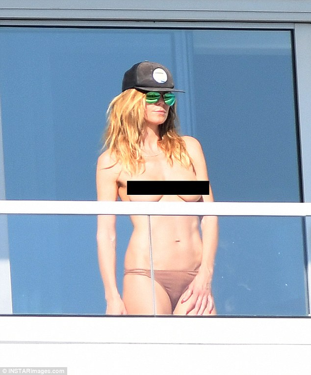 Image result for heidi klum caught topless at hotel balcony