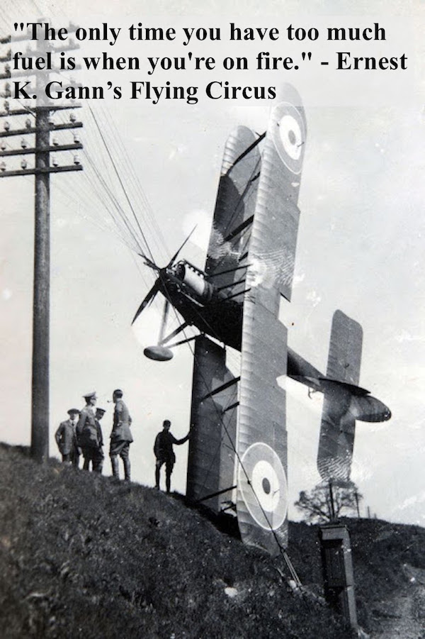 Photo of a crashed WWI airplane, tangled in power lines. British soldiers examine the wreck. Quote Gann's Flying Circus. 'The only time you have too much fuels is when you are on fire. Dogfights and other stories of pilots. marchmatron.com