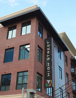 HIGH STREET apartment signage running upwards vertically