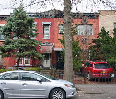 Two story red brick duplex - row house