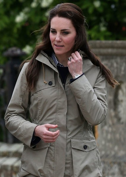 Kate Middleton wore Troy London Wax Parka, Jigsaw Cashmere Jumper, Zara Trousers, Penelope Chilvers boot, Kiki Lauren Earrings