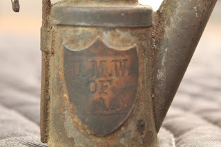 Metal miners lamp with a shield and the letters U.M.W. of A.