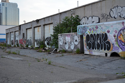 Former Bayside Oil garage and shop with graffiti on it