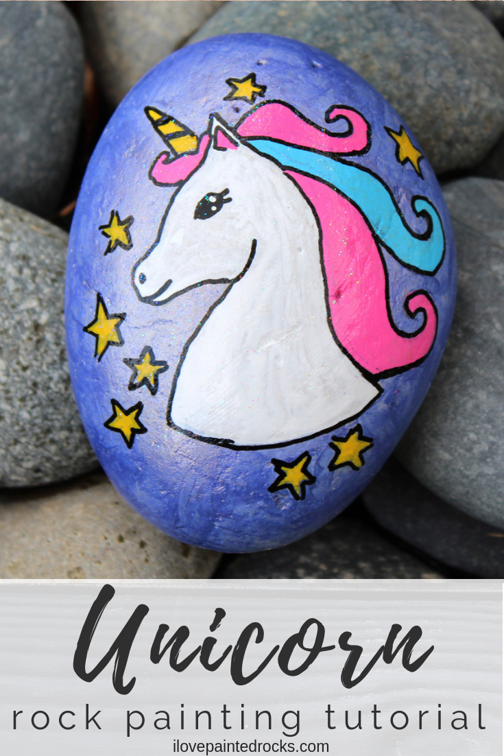 Learn how to draw a unicorn on a painted rock. This pretty unicorn craft project is an easy DIY craft for teens or older kids. You will learn how to draw a unicorn with the help of a stencil and turn it into a magical rock painting project. #ilovepaintedrocks #unicorncrafts #unicorns #paintedrocks #rockpainting #rockpaintingideas #painting #stenciling #stencils #rockart #stonepainting