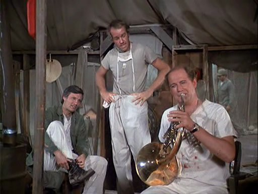 Torments His Tentmates Alan Alda And Mike Farrell In The Mash Episode The Smell Of Music