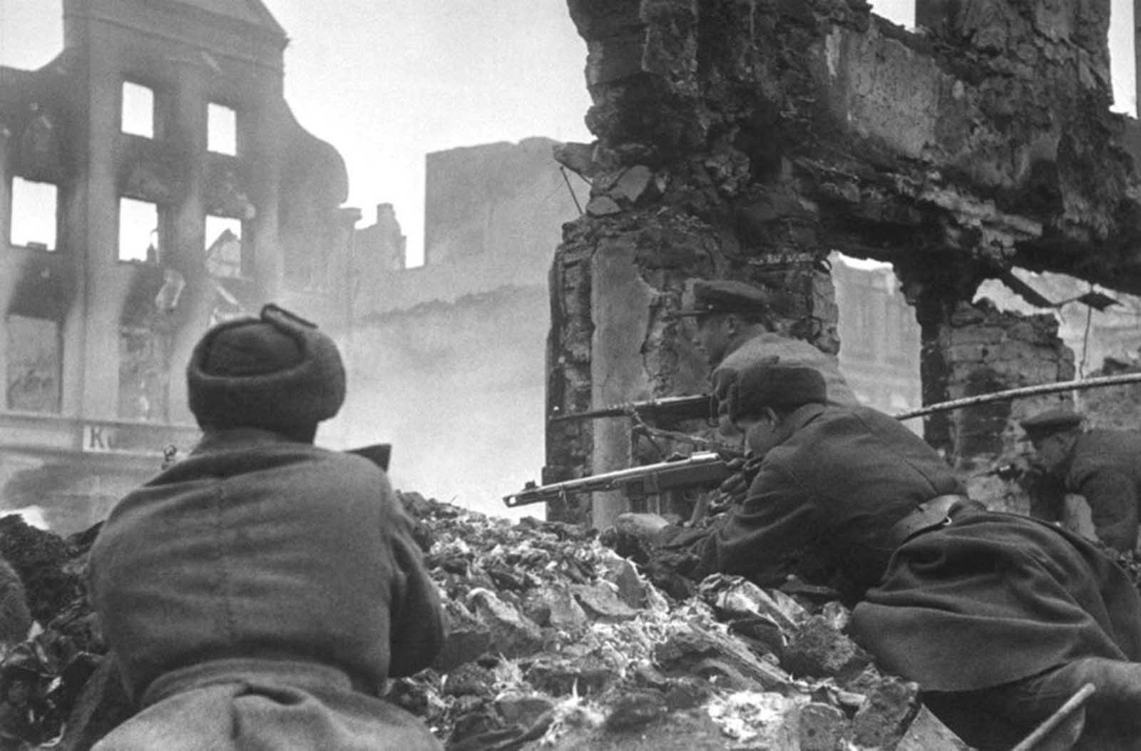 Soviet soldiers lead house-to-house fighting in the outskirts of Königsberg, East Prussia, Germany, in April of 1945.