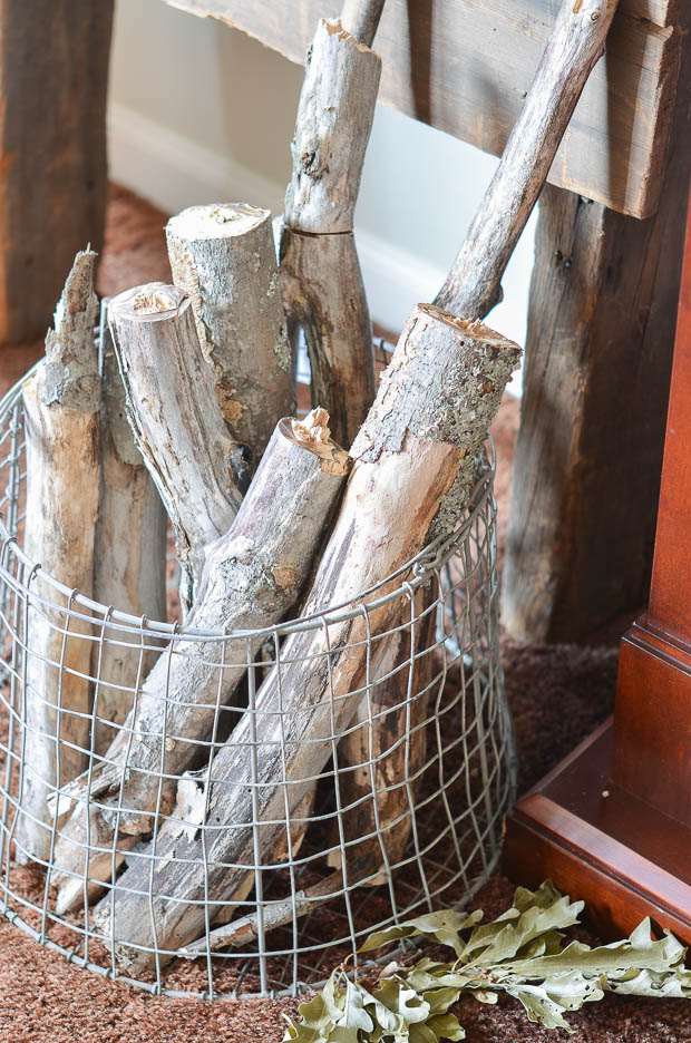 Add a kindling basket full of logs next to your fireplace.