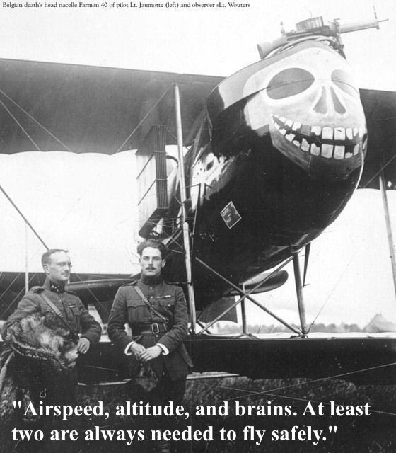 "Photo of Belgian ""Death's Head"" airplane, pilot Lt. Jaumotte and stand by biplane, leaning on a wing. Large skull painted on the nose of the plane. Dogfights and other stories of pilots. marchmatron.com"
