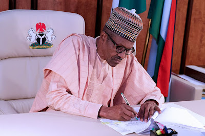 President Buhari Signs 8 New Bills Into Law