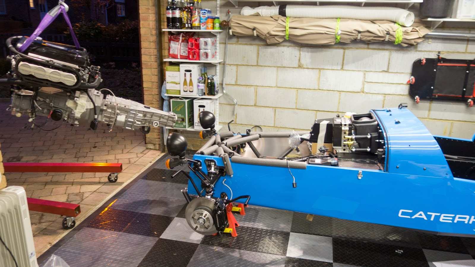 R500 engine with gearbox attached and strapped to engine crane.