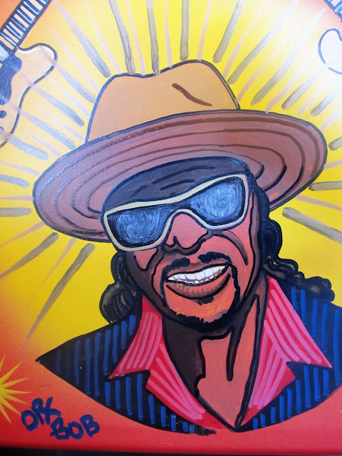 Detail of Chuck Brown by Dr. Bob. Acrylic on metal chair, c.2015