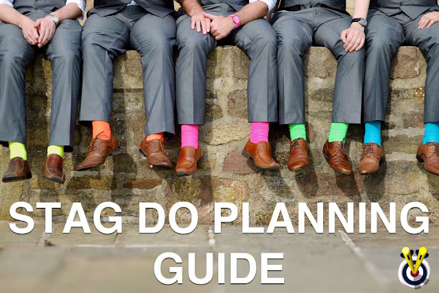 Men sitting on a wall with a Stag Do Planning Guide