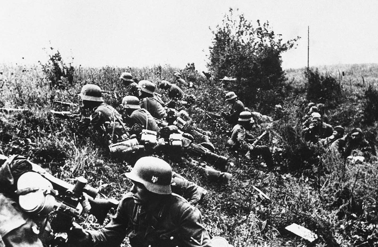 Nazi troops lie concealed in the undergrowth during the fighting prior to the capture of Kiev, Ukraine, in 1941.