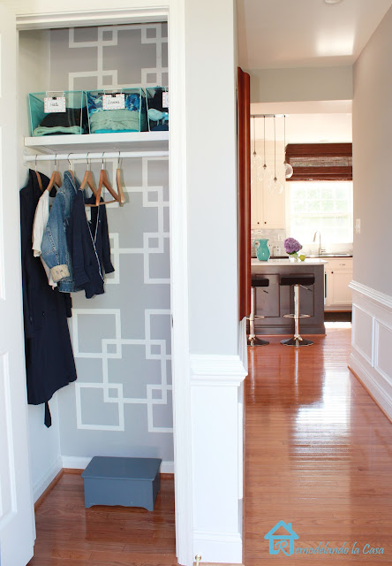 small closet makeover with geometric design on wall- kitchen in the back