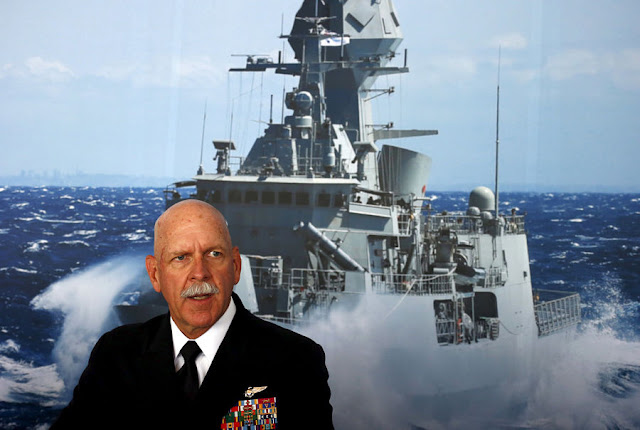 FILE PHOTO: Commander of the U.S. Pacific Fleet Admiral Scott Swift sits in front of a large poster of an Australian Navy frigate as he speaks during a media conference at the 2015 Pacific International Maritime Exposition in Sydney, Australia, October 6, 2015. REUTERS/David Gray/File Photo