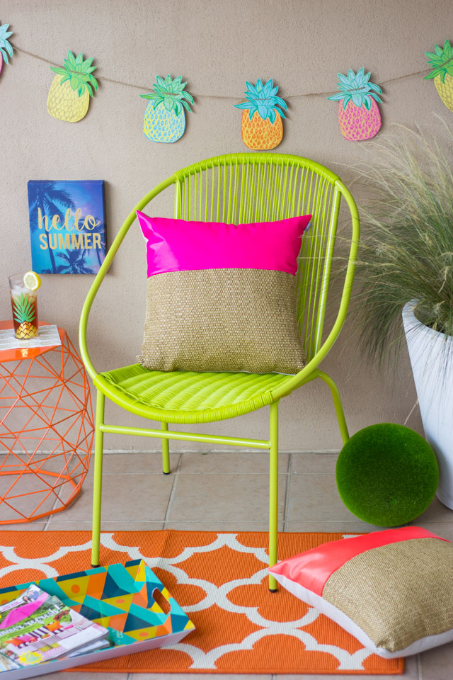 Make a special outdoor reading nook with summery colors and pineapple decor. The perfect spot for a summer staycation!