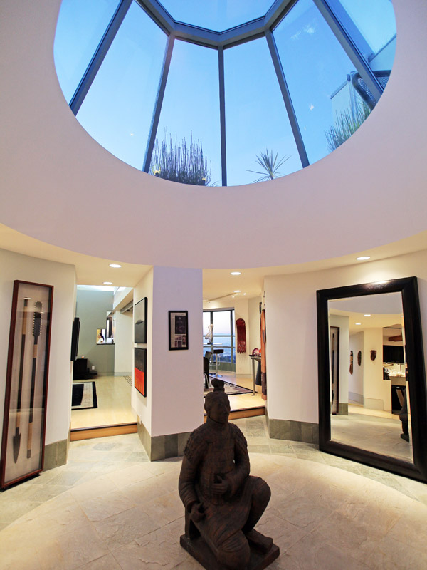 Photo of incredible hallway interiors with Buddha statue in the middle and roof window on the ceiling