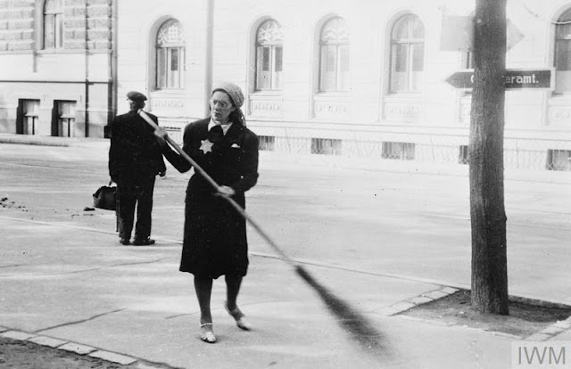 Sweeping streets in Riga, 22 August 1941 worldwartwo.filminspector.com