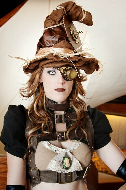 Steampunk Halloween costume ideas for women. This steampunk witch has a witch's hat, monocle/eyepatch/goggle, victorian cameo bra, harness and gloves.
