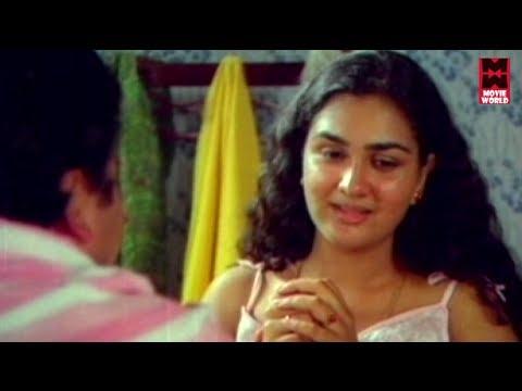 Swargangal swapnam kaanum mannin madiyil Lyrics - Malooty