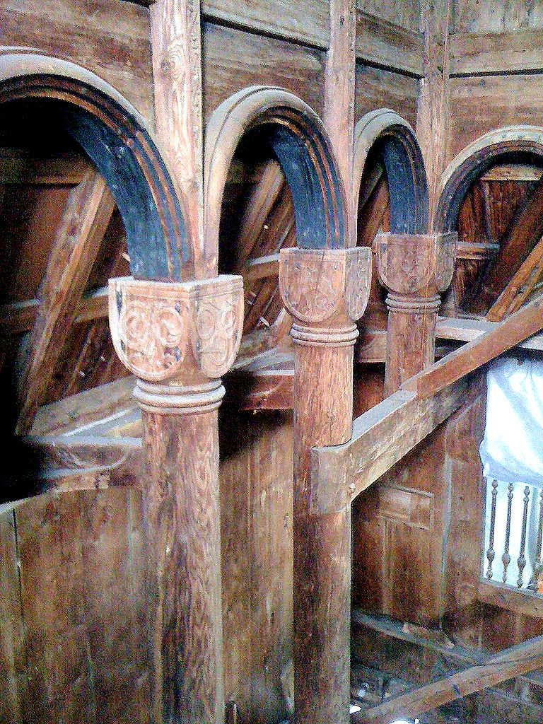 Note how the Norwegians achieved Roman-style architecture in their wooden craftsmanship by constructing and sculpting columns, capitals and semi-circular arches. This photo only: Marlene Wilson.