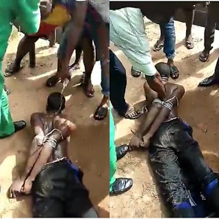 Photos/Video: Another man beaten and tied up in Abia State after he was caught wearing a shirt he allegedly stole