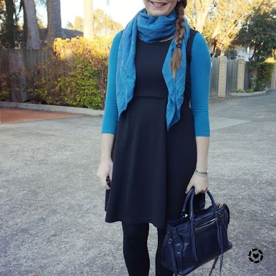 awayfromtheblue instagram | teal long sleeve tee under little black fit and flare dress business casual outfit