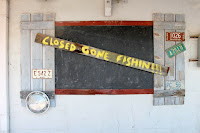 picture of a gone fishing sign