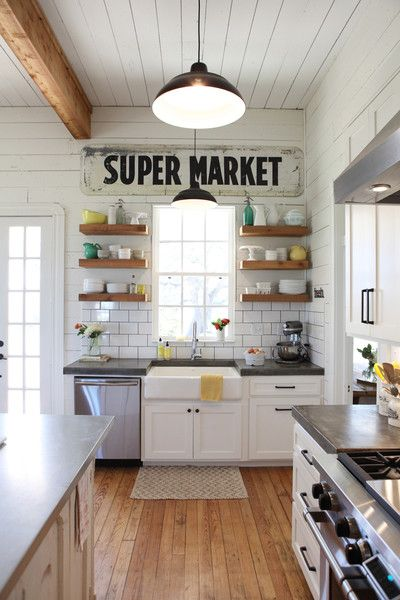 White modern farmhouse kitchen with Supermarket sign, farm sink open shelves, Fixer Upper, Joanna Gaines
