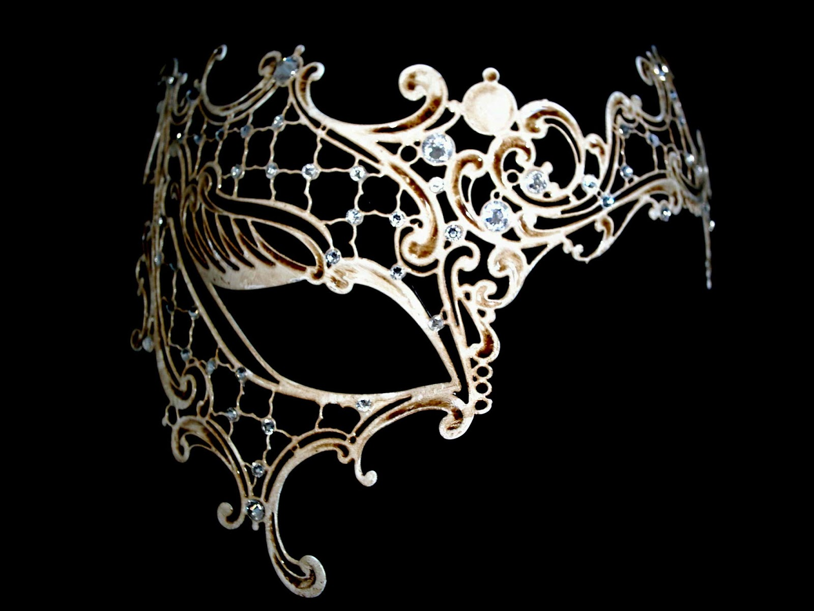 http://www.simplymasquerade.co.uk/masqueradeshop/prod_152311-Occhialino-Venetian-Filigree-Masquerade-Mask-Antique-White.html