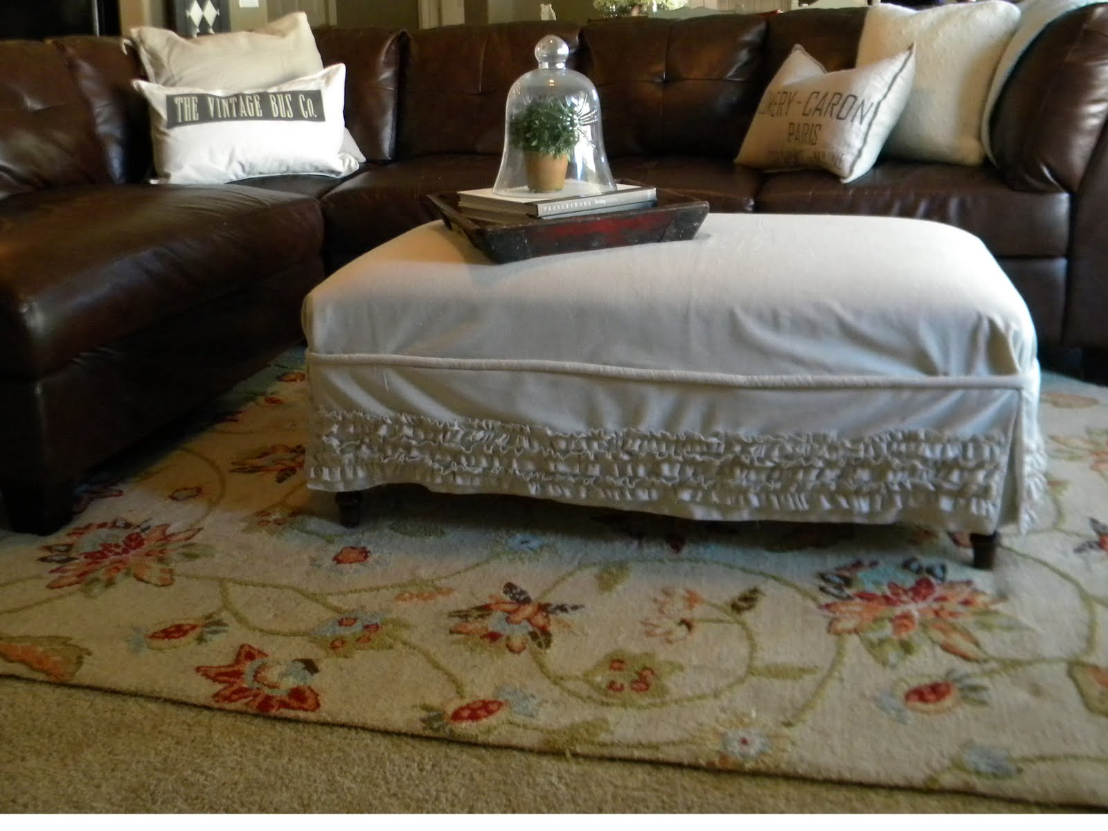 Grand Design Slip Covered Ottoman