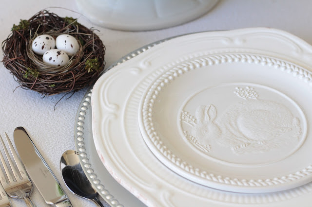 neutral easter tablescape white plates nest eggs simple easter decor