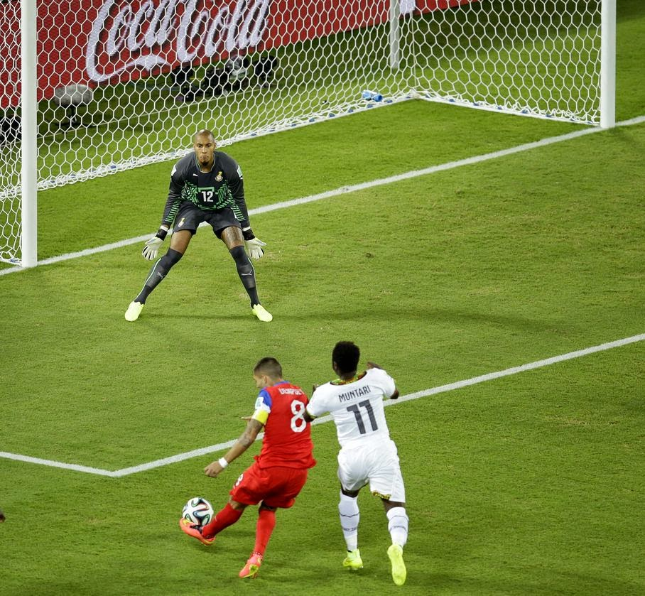 United States' Clint Dempsey, bottom left, scores the opening goal past Ghana's goalkeeper Adam Kwarasey, top, during the group G World Cup soccer match between Ghana and the United States at the Arena das Dunas in Natal, Brazil, Monday, June 16, 2014.
