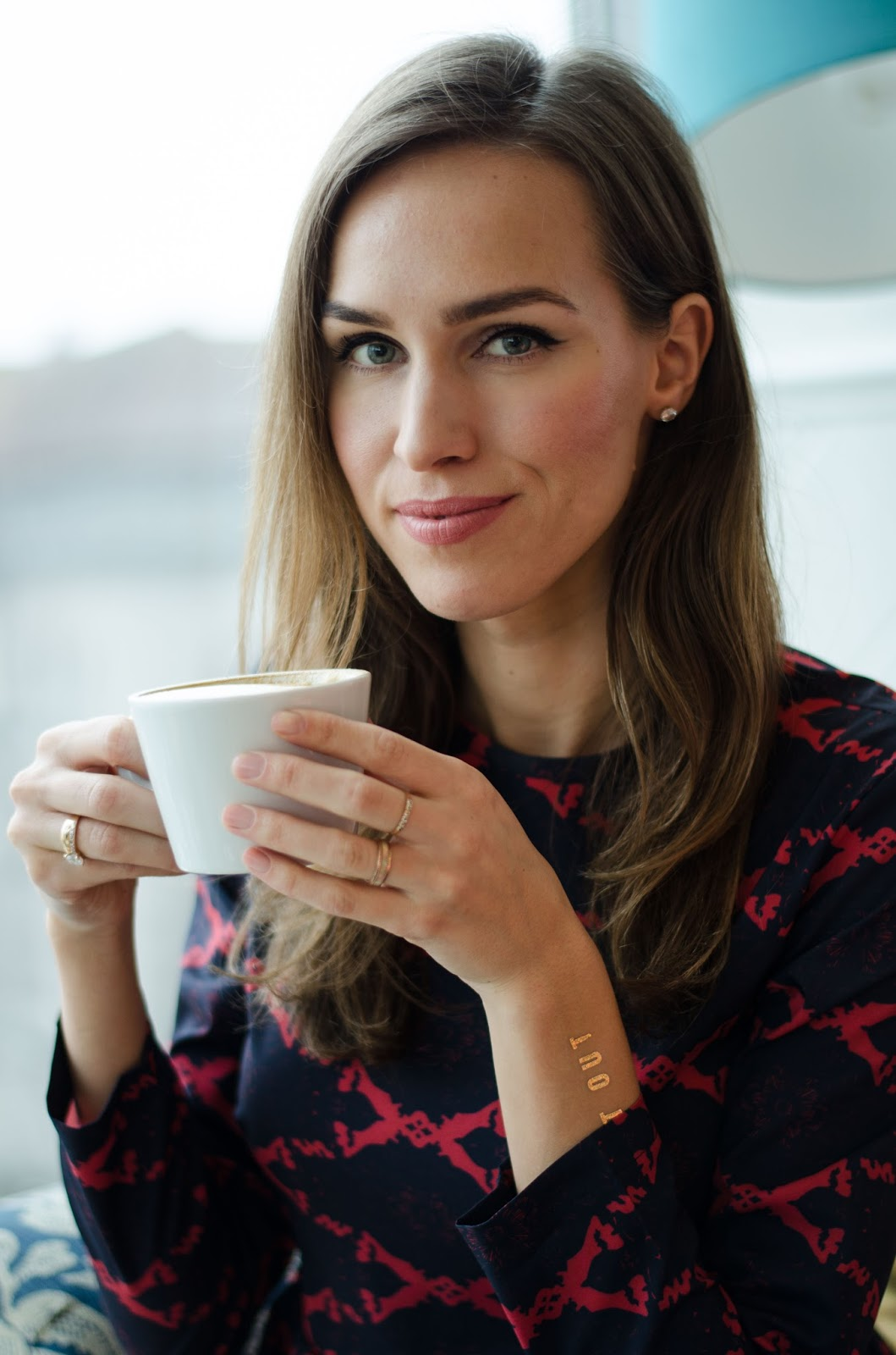 kristjaana mere coffee drinking in cafe