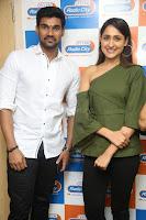 Pragya Jaiswal in a single Sleeves Off Shoulder Green Top Black Leggings promoting JJN Movie at Radio City 10.08.2017 113.JPG