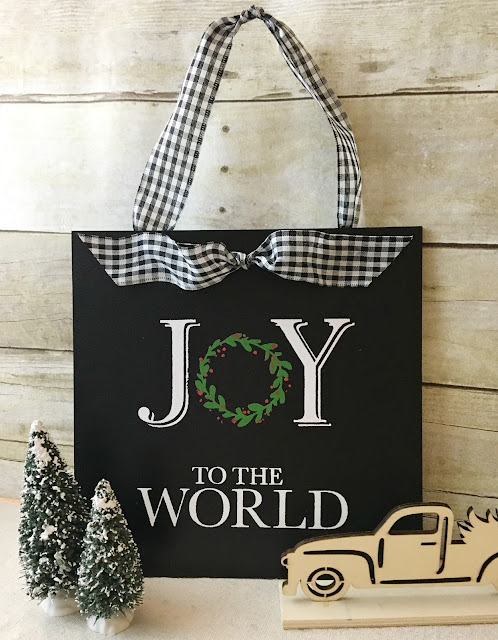Vintage Paint and more... Joy to the World transfer done in chalk on a black chalkboard with a black and white check ribbon added