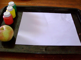 Making apple prints with paint.