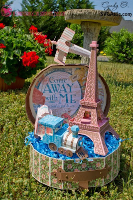 3d paper display with travel case, Eiffel tower, train and plane.