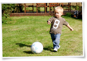 Child learning to kick a ball