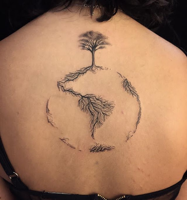 earth planet tattoo on back