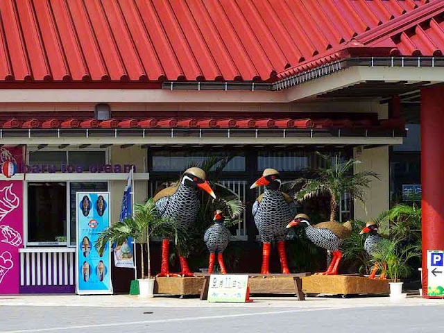 Okinawan Rail or Kuina bird statues outside a restaurant