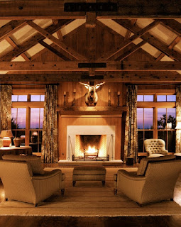 Unusual Ornament in the Sitting Space with Rustic Fireplace Mantels and Brown Sofas under the Wooden Ceiling