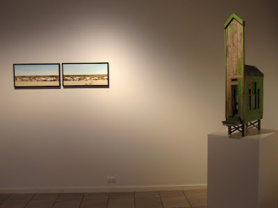 Two wall pieces and a building on display at the Alex Asch exhibition at Beaver Galleries.