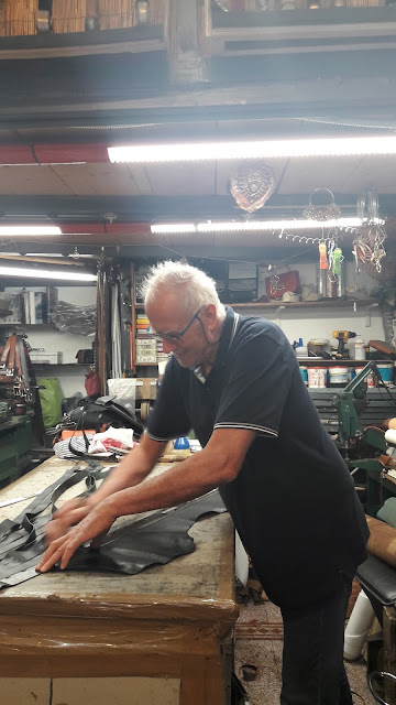 Siena leather artisan in his worskhop