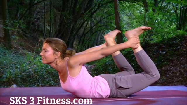Yoga Girl doing Dhanurasana - Bow Pose